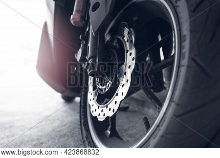 Closeup Disc Brake Of A Scooter. Aluminum Alloy Wheel Of Motorcycle. Steel Rims. Mag Wheels Of Motor