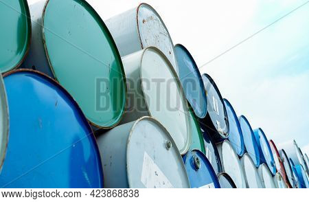 Old Chemical Barrels. Blue And Green Oil Drum. Empty Steel Oil Tank. Toxic Waste Warehouse. Hazard C