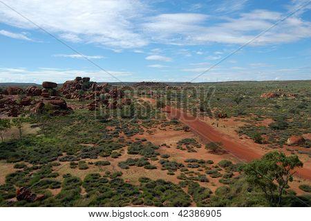 Outback Australia Red Rocks In Bush