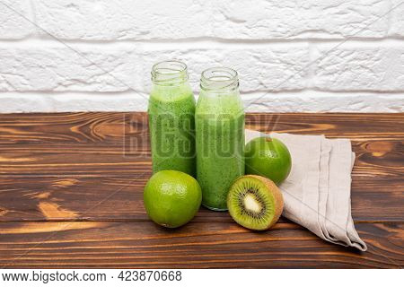 Fresh Green Smoothie With Cereals. Green Cocktail Spinach Smoothie In A Glass. Spinach Milkshake On