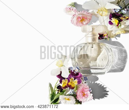 A Bottle Of Perfume With Flowers On White Background, Isolated. Floral Fragrance For Summer Time. Li