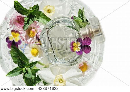 A Bottle Of Perfume In A Crystal Vase With Summer Flowers. Light And Airy Fragrance For Hot Season.