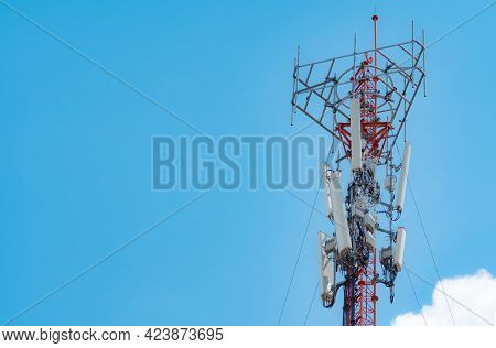 Telecommunication Tower With Blue Sky And White Cloud Background. The Antenna On Blue Sky. Radio And