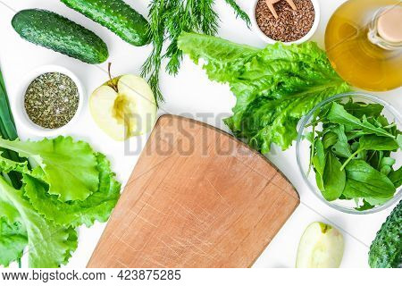 Cooking Healthy Diet Or Vegetarian Food. Cutting Board Surrounded By Green Vegetables. Step By Step