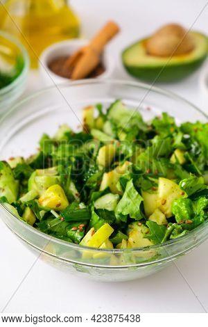 Salad Of Fresh Green Vegetables And Herbs. Cooking Healthy Diet Or Vegetarian Food. Step By Step Rec