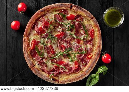 Top View Of Pizza With Cabanossi, Salami, Bacon And Prosciutto