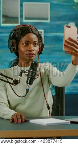 African Woman Using Smartphone Taking Selfie In Entertainment Business Recording Episode. On-air Onl