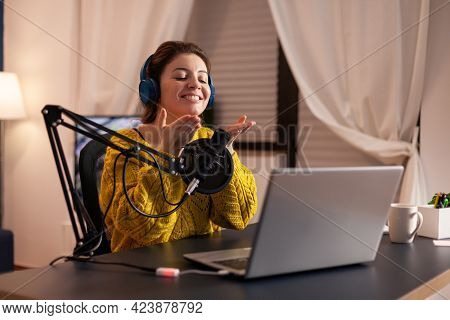 Vlogger Speaking With Follower On Live Using Professional Microphone Wearing Headphones. Creative On