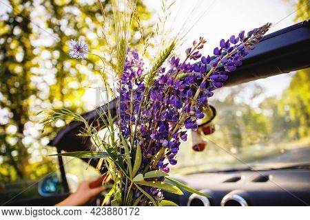 Closeup Of Driving In Cabriolet Car On Sunny Summer Day. Couple Traveling Or Having Romantic Date In