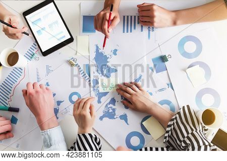 Business Planning Process With Colleagues Or Partners Sitting Together At The Table With Different G