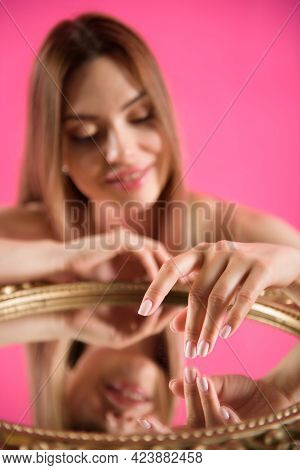 Portrait Of A Beautiful Girl On A Pink Background.