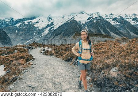 New Zealand tramper backpacking on Mount Cook Aoraki Hooker valley travel. Hiker hiking walking on Hooker Valley Track in summer on travel holiday adventure