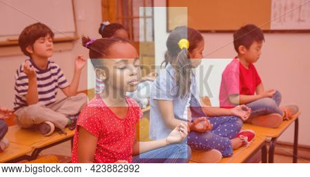 Composition of flag of switzerland over happy schoolchildren meditating in class. school, education and study concept digitally generated image.