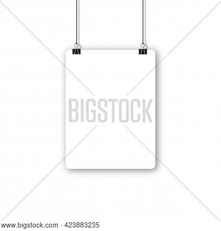 Blank Poster Hanging On A Binder Clips. A4 White Paper Sheet Hangs On A Rope With Clips.