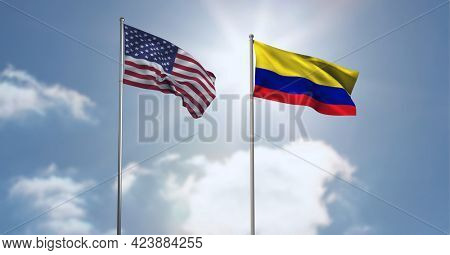 American and columbia flag waving against clouds in blue sky. international relations and affairs concept
