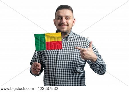 White Guy Holding A Flag Of Benin And Points The Finger Of The Other Hand At The Flag Isolated On A