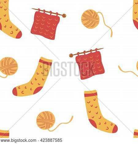 Seamless Pattern With Socks And Knitting. Ball Of Thread, Knitting Needles And Socks. Cute Winter Or