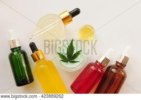 Marijuana Leaves, Cbd Oil, Cosmetic Cream. Cannabis Extract In Cosmetology. Flat Lay, Powder Backgro