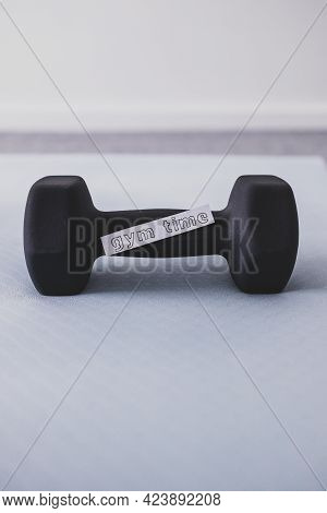 Home Gym And Exercising, Dumbbell On Yoga Mat On Bedroom Floor With Get Stronger Workout And Gym Tim