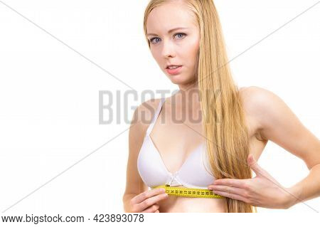 Young Slim Woman Wearing Bra With Yellow Measure Tape Measuring Her Chest Under Breast, On White. Bo
