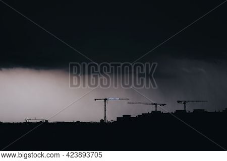 Dark Construction Cityscape In Storm Strasbourg France. Clouds, Rain And Rooftop Silhouette. Urbaniz