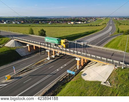 Moscow , Russia - SPT 23, 2020: Truck with Cargo Semi Trailer with company logo for Pilkington Moving on Rural Road in Direction. Aerial Top View. Pilkington is a  glass-manufacturing company