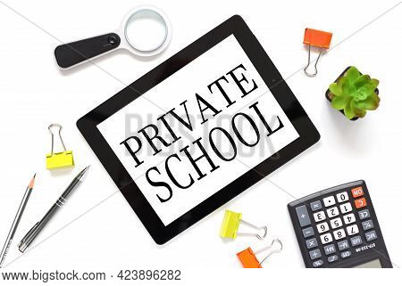 Private School. The Text Is Written On A White Tablet Screen. The Tablet Lies On A White Workspace N