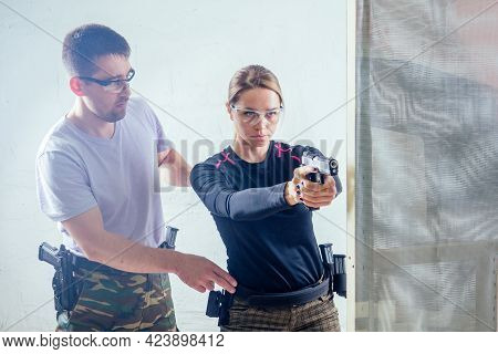 A Woman Target Practicing With A Handgun For Self Defense