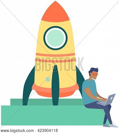 Man Working On Business Startup. Launch Of Rocket Standing On Pedestal. Man With Laptop Works With I