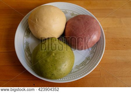 Selective Focus Of Colorful Handmade Dough On Plate With Light And Shadow, Three Balls Of Fresh Home