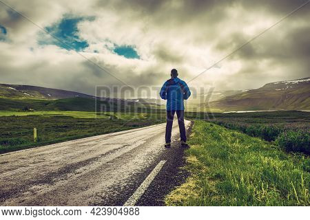 Traveler Standing On The Ring Road Of Iceland Enjoying The Scenery. Travel Outdoor Concept.