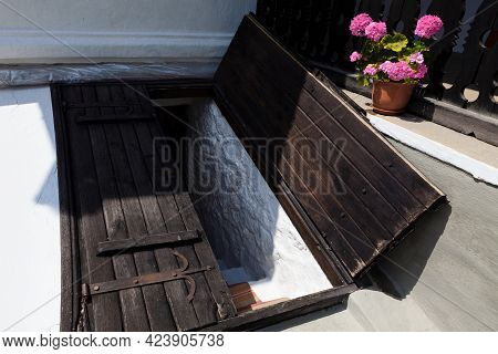 Wooden Doors Of Underground Wine Cellar . Entrance To Traditional Rustic Cellar