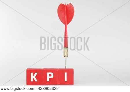 Cubes And Red Arrows With The Letters Kpi