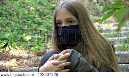 Sick Child Wearing Protective Mask Due Coronavirus Pandemic, Sad Girl Isolated In Park, Bored Unhapp
