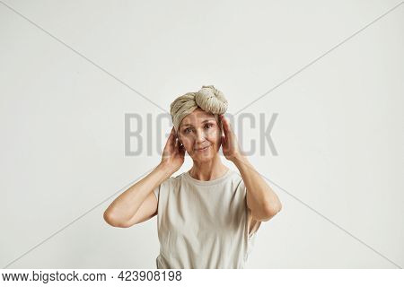 Minimal Waist Up Portrait Of Beautiful Mature Woman Wearing Headscarf And Dress Looking At Camera Dr