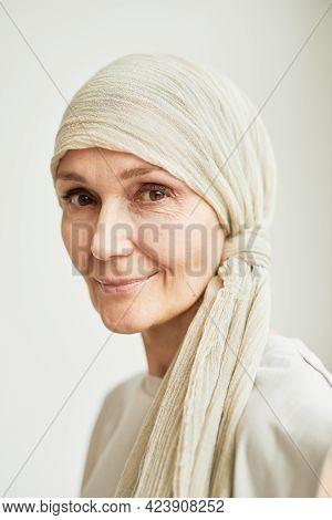 Minimal Headshot Portrait Of Beautiful Mature Woman Wearing Headscarf And Looking At Camera