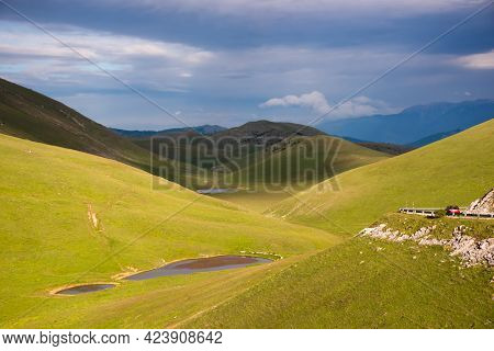 Natural Landscape With Green Pastures On Gentle Hills