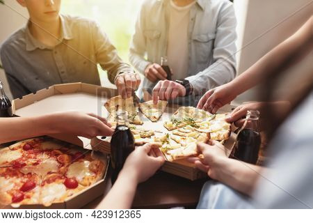 A Pizza Party, A Group Of Friends Chatting And Happily Eating Pizza At The Table And Drinking Sweet