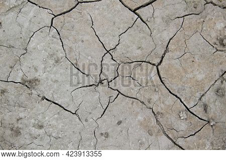 The Texture From Cracked Dry Earth.  Cracks Against Background