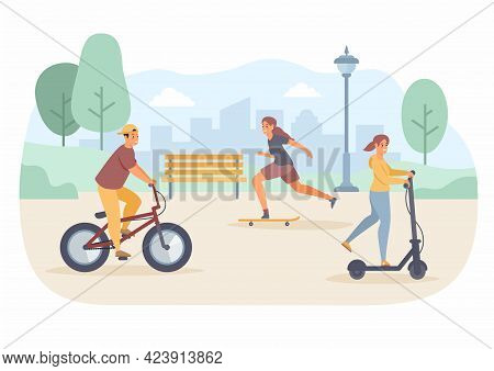 People Ride In Park. Guy In Baseball Cap Rides Bicycle. Teenage Girls Have Fun Riding Scooter And Sk