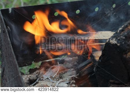 Bonfire Fire With Smoke Close-up In The Dark On A Black Background. Burning Wood, Wood