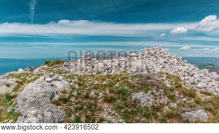 Close Up Of Mountain Rilic Peak Sutivid Covered With White Stones. Biokovo Mountain In The Backgroun
