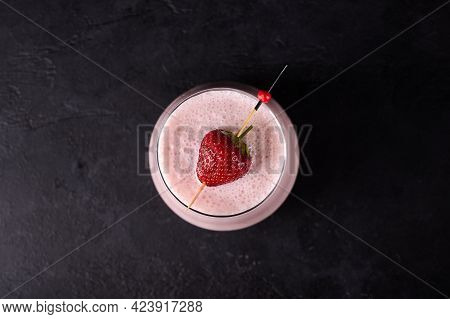 Lassi Is Traditional Indian Cold Refreshing Drink With Yoghurt, Strawberry And Ice. Perfectly Quench