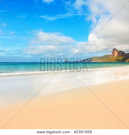 Beach and sea. Island on the background