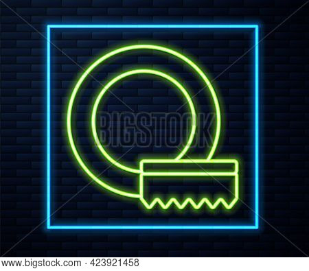 Glowing Neon Line Washing Dishes Icon Isolated On Brick Wall Background. Cleaning Dishes Icon. Dishw