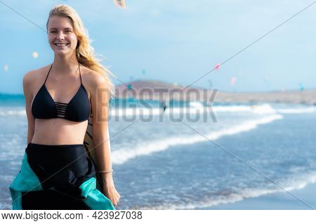 Young Sexy Blonde Woman With Long Hairs. Smiling And Posing With Surf Board Near Blue Ocean In Sunny
