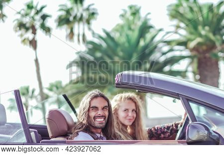 Freedom Of The Open Road. Side View Of Joyful Young Man Relaxing On The Front Seat While His Girlfri