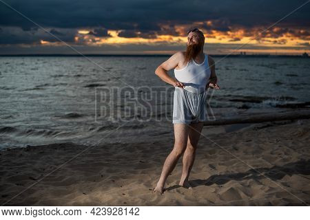 A Brutal Bald Man Posing On The Beach At Sunset Parody Glamorous Chick