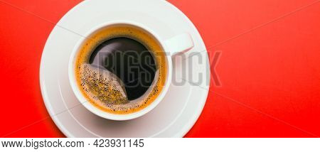 Cup of black coffee on table top view, flat lay, mock up. Cup of Black Coffee in White Ceramic Cup on plastic Tabletop
