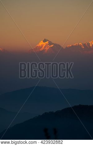 Enjoying The Beautiful View Of Trishul Peak While The Last Rays Of Sun Hits The Golden Peaks During